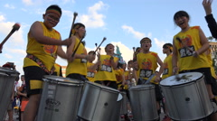 Asian drum band plays upbeat South American music, carnival parade in Taiwan Stock Footage