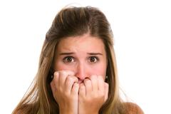 Hispanic young woman with fear expression and hands on face. Stock Photos