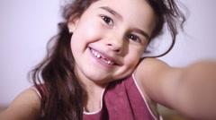 Teen girl toothless smile selfie makes Stock Footage
