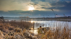 4k timelapse of lake at evening in springtime.  - stock footage
