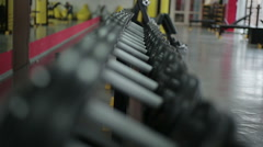 Exercise equipment prepared for active training at fitness club, rack focus shot Stock Footage