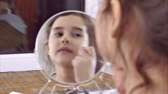 Stock Video Footage of teen girl doing makeup eyebrow comb indoor