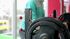 Fitness trainer assisting athlete in barbell exercise, motivating with thumb up Stock Footage