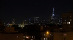 Downtown Manhattan skyline at night, seen from Brooklyn Stock Footage