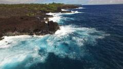Aerial shot of ocean coastline - waves washing up on a rock, Hawaii Arkistovideo