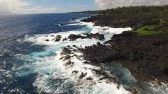 Flight over of ocean coastline - waves washing up on a rock, Hawaii Stock Footage