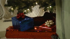 Christmas Eve Visit from Santa Claus - presents under tree - stock footage