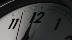Slow zoom in as the clock strikes 12 o'clock Stock Footage