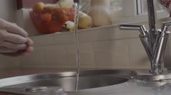 Washing Hands In A Domestic Kitchen - stock footage
