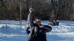 Man fires starting pistol at speed skating event Stock Footage