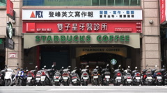 Asian Starbucks coffee branch, motorbike parking lot, Taipei city, Taiwan Stock Footage