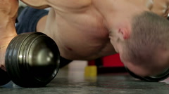 Strong sportive man doing dumbbell push-up exercise, preparing for competition Stock Footage