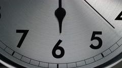 Clock face showing the hour hand on number 6 as the seconds hand ticks past Stock Footage