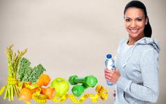 Young asian woman with bottle of water. - stock photo