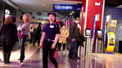 Close up corridor of people leaving and coming the movie theater - stock footage
