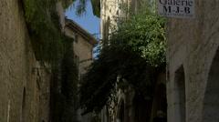 Tilt up of the Galerie M.J.B sign on Rue Grande in Saint-Paul-de-Vence Stock Footage
