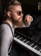 Attractive young pianist is making a break Stock Photos