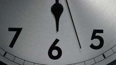Slow zoom in to the number 6 of a clock face as the seconds hand ticks by Stock Footage