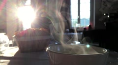 Breakfast is fresh coffee , hot steam from the coffee morning sun illuminates Stock Footage