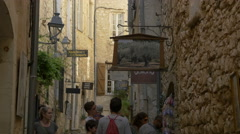 Tourists walking on Rue Grande, visiting the art galleries, Saint-Paul-de-Vence Stock Footage