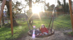 Children Having Fun On A Giant Swing Stock Footage