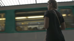 Tourist visiting city using Paris train system. - stock footage