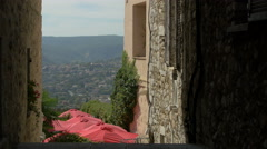 High angle view of the restaurant's red outdoor umbrellas in Saint-Paul-de-Vence Stock Footage