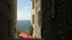 An outdoor restaurant seen from a sloped street, Saint-Paul-de-Vence Stock Footage