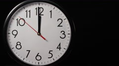 Circular wall clock ticking towards 12 o'clock Stock Footage