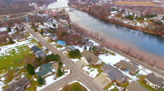 Aerial view of small town USA, neighborhoods, scenic river, springtime Stock Footage