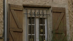 Window with open shutters and an inscription in Saint-Paul-de-Vence Stock Footage