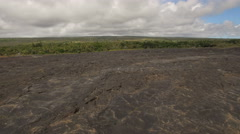 Aerial shot of lava rock field in Hawaii, Backward fly. Arkistovideo