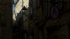 People walking by the galleries and stores on Rue Grande, Saint-Paul-de-Vence Stock Footage