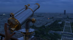 Looking glass binoculars being used on Eiffel Tower Stock Footage