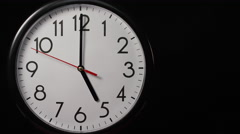 Circular wall clock ticking towards 5 o'clock, with copy space Stock Footage