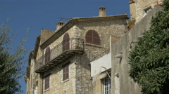 Stone building with closed shutters and a balcony in Saint-Paul-de-Vence - stock footage