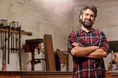 Small carpentry business owner smiling with arms crossed Kuvituskuvat