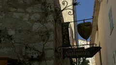View of La Fenice Antiquités shop sign in Saint-Paul-de-Vence Stock Footage