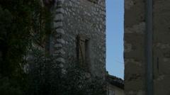 Tilt up of the sky seen through the stone walls in Saint-Paul-de-Vence - stock footage