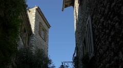 Blue sky behind stone buildings in Saint-Paul-de-Vence Stock Footage