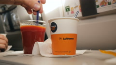 Tomato juice with pepper and coffee airplane Stock Footage