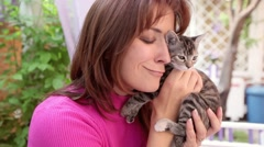 A beautiful girl cuddle a kitten. Portrait . Video of love for animals Stock Footage