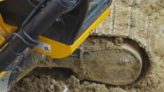 Excavator always be on firm, level ground. 4k, Cloose-up Stock Footage