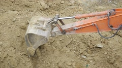 Excavators working simultaneously. Two crawler excavator buckets operating - stock footage