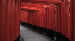 Red torii gates at Fushimi-Inari Shrine, Kyoto, Japan Stock Footage