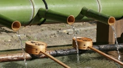 Water fountain at a Buddhist temple, Kyoto, Japan Stock Footage
