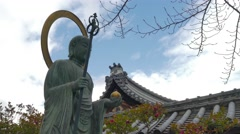 Bronze statue of Buddha in front of a temple, Kyoto, Japan Stock Footage