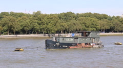 Houseboat moored in middle of river Thames, London, UK - stock footage