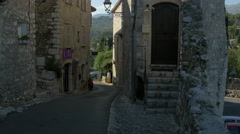 Tilt up of stone buildings on Rue de la Pourtoune in Saint-Paul-de-Vence Stock Footage