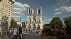 Sightseeing tour bus on Paris street with Parisian skyline behind. - stock footage